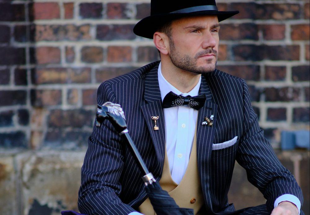 model wearing pinstripe suit